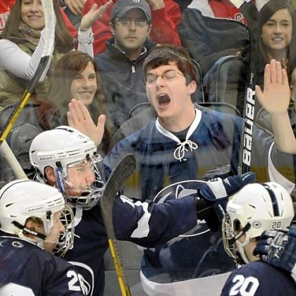 A Penn State fan celebrates as players from the Nittany Lions mob Casey Bailey (second from left) after he scored a goal in the second period against Ohio State at the Three Rivers Hockey Classic at Consol Energy Center. Total attendance for the two-day Classic was 22,460.
