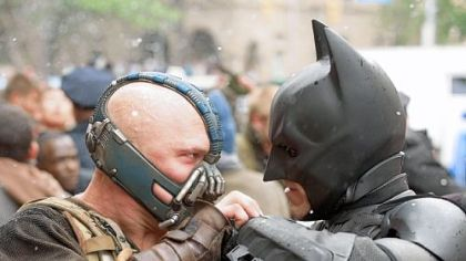 "As Bane, Tom Hardy goes head to head with Christian Bale's Batman in this summer's ""The Dark Knight Rises."""