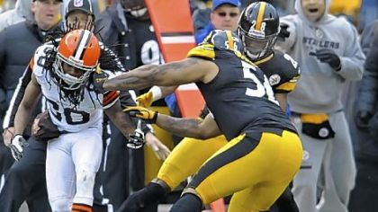 Steelers cornerback Cortez Allen forces a fumble against the Browns' Travis Benjamin in the fourth quarter Sunday at Heinz Field.