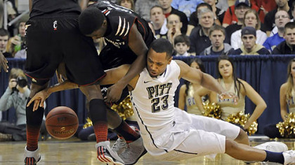 Pitt's Trey Zeigler gets called for a foul as he reaches for a loose ball against Cincinnati's Shaquille Thomas in the first half at the Petersen Events Center.