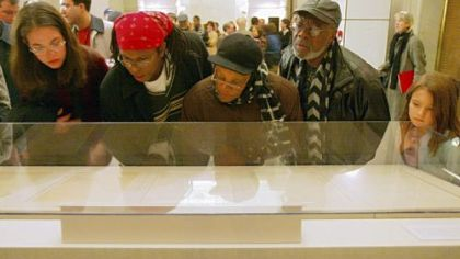 Visitors view the original Emancipation Proclamation during a one-day-only exhibit Jan. 19, 2003, at the National Archives in Washington.