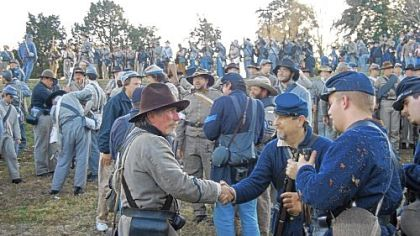 Confederate and Union soldiers shake hands after the 150th anniversary re-enactment of the Battle of Fredericksburg on Dec. 8, 2012.