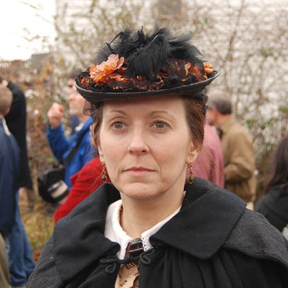 "Christine Zukonski of Bayville, N.Y. has been a Civil War re-enactor for 15 years with her husband, Edward, a member of the 57th Virginia because ""he loves Virginia."" A spectator teased her:  ""You could hide a couple Rebels under that dress."""