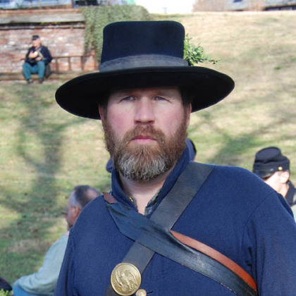 "Michael Houston of Fawn, Pa., has been a member of the 78th Pennsylvania re-enactment unit for 11 years. One of his ancestors fought in the same Union regiment during the Civil War. Others fought for the Confederacy. ""I wanted to know what my ancestors experienced. It was a hard life. We're only out here for a weekend."""