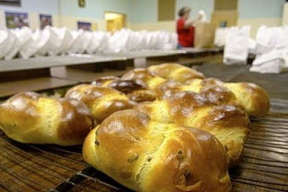 Easter bread is packaged in sacks before being sold at Holy Redeemer Parish in Ellwood City. Approximately 1,600 loaves are made and sold each year.