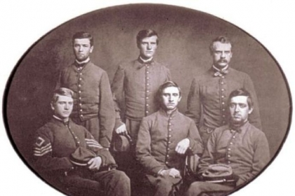 This photo, made in May 1861, shows the Pittsburgh Rifles wearing gray uniforms supplied by Pittsburgh citizens. The men later joined Company A of the 9th Pennsylvania Reserves. In the front row, left to right, are Sergeant Hartley Howard, Private George T. Robinson and Private George W. Dilworth. From left to right in the back row are Private John S. Copley, Private George J. Hazlett and Abner Updegraff Howard, brother of Sgt. Hartley Howard.